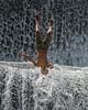 Back flip (tmeallen) Tags: boy coolingoff hotday sunshine upsidedown waterfall cascadingwater havingfun summerfun tukadundadam semarapura bali indonesia backflip diving swimtrunks klungkung