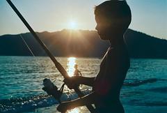 Stubbornness (Pierre le Long) Tags: sunset hobby pleasure joy relax quality fishing sea sun summer holidays ignorance youth analog iso200 greece corfu film 50mm fujicolor nikon