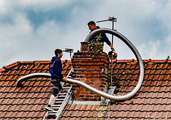 Just How Long Is This Tapeworm? (Fermat48) Tags: flue gasfitter chimney stainlesssteel liner ladder roof tvaerial sky clouds canon eos 7dmarkii tapeworm pipe cowling brickwork ridgetiles