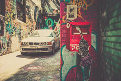 BMW (JonShootsStreetPoorly) Tags: 40mm bmw leicam people automobile car color colour contrast dreamy finder golden graf graffiti graffitiart hidden iconic konica laneway leica life mrokkor m9 minolta pastel photography photos range rangefinder rokkor shadow shot smooth snap street streetphotography streetscene streetshooter streetshot streetview streets sunny sunshine toning tourists travel urbanpeople urbanstreet urbanview vehicle warm