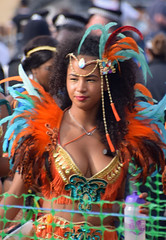 DSC_3578b Notting Hill Caribbean Carnival London Exotic Colourful Orange and Gold Costume with Orange and Turquoise Feathers Showgirl Performer Aug 28 2017 Stunning Lady (photographer695) Tags: notting hill caribbean carnival london exotic colourful costume showgirl performer aug 28 2017 stunning lady orange gold with turquoise feathers