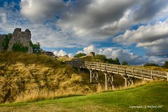 The bridge to Castle Acre (Holfo) Tags: norfolk castleacre bridge englishheritage clouds sunlight nikon d750 sky landscape summer span england britain arch arched walkway moat spanned spanning eastanglia wonderful fave superb dramatic old ancient