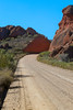 The long Dusty road to the Red mountains of Calitzdorp (charissadescande) Tags: africa rock dry arch place inhospitable western south background red roadway locations seweweekspoort scenic sky cactus cape province oudtshoorn scene hill stone landscape sunset range view rocky mountains calitzdorp formation vegetation natural gravel clouds redish horizon blue colorful sheer geological pass plants nature travel majestic karoo african light dirt mountain