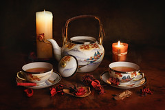 Tea at candlelight (RobertFenyo) Tags: stilllife indoor cup candle candlelight dark tea teatime