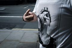 dope... (jrockar) Tags: street streetphoto streetphotography london candid moment instant decisive man eminem tshirt hand gesture guy cool longexposure long exposure motion blur motionblur westfromeast ordinarymadness ordinary madness fuji fujix fujifeed x100f holyf jrockar janrockar idiot dope rapper musician celebrity celeb