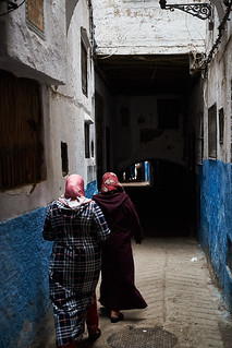 Veiled women in djellaba walking in medina, Tétouan, Morocco