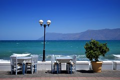 summer moods (JoannaRB2009) Tags: summer mood blue landscape seascape view ropotamos hill mountain peninsula seafront coast coastline lamp table chairs restaurant kissamos crete kreta kriti greece greek sunny hot plant water sea maditerranean bay