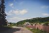 Countryside (BalintL) Tags: ukraine fujifilm xe1 samyang 21mm f14 carpathians countryside village street bad road cluds sky