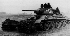 Tank T-34/76 equipped with a mine trawl , armed with the 1st armored brigade named after the Westerplatte Heroes Polish army. 1953.