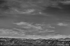 Death Valley - Passing Clouds (www.karltonhuberphotography.com) Tags: 2014 adventure amaving bw beautiful blackandwhite bluesky california clouds creativeperspective deathvalley deathvalleynationalpark desert desertscape details exploring happy horizon horizontal karltonhuber landscape landscapephotography layers monochrome mountainpeaks mountains nationalpark nature naturephotography nikond7000 outdoors peaceful relaxing rolling sky smooth texture