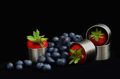 Fruits of Summer (njk1951) Tags: berries strawberries blueberries stilllife red blue onblack blackbackground pewter circles pewterrings napkinrings fruitsofsummer summerfruit summer fruit
