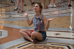Worshipping in Milan's palace of consumerism (Galleria Vittorio Emanuele II) (Phototravelography) Tags: galleriavittorioemanuele italie italy lombardei lombardy mailand milano blond concentration floor foolingaround fun girl marble milan mosaic prayer woman worship yoga zen