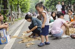 Playtime (foureightseven) Tags: child road blocks build play joy vietnam hanoi wooden boy fun