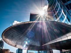 Flying saucer (Le petit oiseau va...) Tags: city cityscape sun flare reflexion reflet reflets urban building buildings lights light architecture paris ladéfense olympus omd tower edf