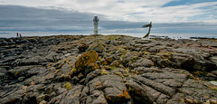 The little lighthouse explored (einisson) Tags: iceland akranes lighthouse stones clouds people outdoor einisson canon70d