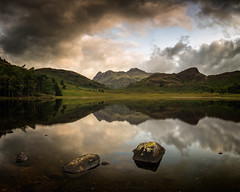 sitting in silence. (akh1981) Tags: mountains manfrotto moody travel trees tranquil nikon nisi landscape lakedistrict tarn cumbria clouds rocks reflections green outdoors water wideangle walking
