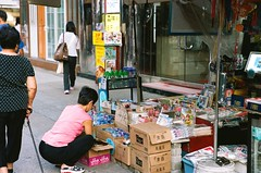 Newsstand (superzookeeper) Tags: people eos1 analog film hk hongkong canoneos1 ef2470mmf28liiusm eos mk mongkok kodakportra160 portra160 kodak portra newsstand newsagent street