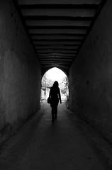 (cherco) Tags: woman walk arch mujer lonely solitario silhouette solitary shadow girl composition composicion canon city ciudad chica urban tunel tunnel light luz blackandwhite blancoynegro