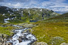 Tindevegen, Jotunheimen (wimvandemeerendonk, back home) Tags: norway jotunheimen water waterfall rapid stream mountain contrast color colors colours colour clouds cloud falls green landscape mountainscape minolta nature nationalpark outdoors outdoor rock rocks sony sky scenic valley wimvandem wild hanksgerry n astoundingimage rockpaper