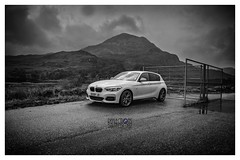 Fortitude in Solitude (Tidyshow) Tags: black white bw bmw m140i contrast border mountain sky clouds heather car auto performance mpower scotland torridon west coast sony 1650 sal1650 a77ii ilca77m2 reflections sgurr dubh