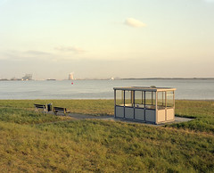Westerschelde near Bath, looking Southeast. August 2017 by Henri-Antoine - What looks like a busstop is a meeting place for people of the village of Bath, just North of Antwerp Harbour, on the Dutch side of the border. I posted another photo of this scene a few days ago, but there were too many imperfections in it for me to hang on to it. Upon consideration, I think that this one works better.    Ebony 45S Fujinon A 240mm 9 Kodak Portra 160 45 sheet film
