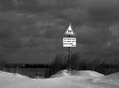 Warning sign (rob kraay) Tags: heavilyclouded dune rocks blackandwhite robkraay sand horizon dunegrass bw sea maasvlakte