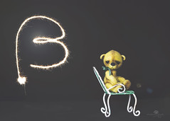button does not like sparklers (rockinmonique) Tags: 52in52 button letters teddy teddybear tiny toy sparkler composite moniquew canon canont6s tamron copyright2017moniquew