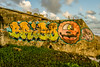 graffitiwall.jpg (BradPerkins) Tags: wood dominicanrepublic sand color decay seawall beach fallingapart concrete urbandecay urbanlandscape wall rotting grafiti