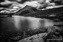 Lake Idwal Snowdonia (Adrian Evans Photography) Tags: grass carneddau idwal water lake idwallake ogwenvalley wales summer uk northwales sky wall stone welshlandscape cwmidwal landscape landmark mountains mono outdoor llynidwal shore longexposure stonewall nationalnaturereserve clouds adrianevans snowdonia penyrolewen rocks park ogwen blackandwhite hdr countryside nikon d800 nd10