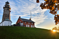 Lighthouse at Sunset (HJharland5) Tags: grass hill sunset sky tree field clouds sunbeam green blue light lighthouse evening leaves autumn pole glass window building landscape