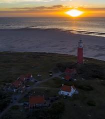 De Vuurtoren op Texel bij ondergaande zon. (MichelSjollema) Tags: decocksdorp texel baken licht light red sky aerialphotography aerial beach sea sunset sun vuurtoren lighthouse