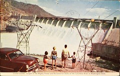 Grand Coulee Dam. Postcard published  by the Washington State Advertising Commisssion, (ca. 1956) (lhboudreau) Tags: postcard vintagepostcard postcards vintagepostcards dam grandcouleedam couleedam outdoor outdoors family automobile car handholding washington washingtonstate stateofwashington columbiariver grandcoulee washingtonstateadvertisingcommission 1956 1950s dams