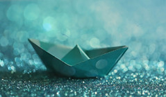Lost at sea...🌊 ⛵ (Through Serena's Lens) Tags: stilllife lostatsea canoneos6dmarkii dof bokeh paper boat blue odc macro 7dwf