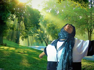 Happy young schoolgirl woman with outstretched arms breathe fresh air, teenager is relaxed after leaving her school