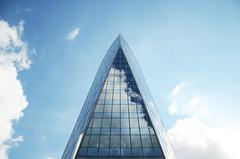 Tour Paradis / Liège (jlnljnphotography) Tags: tour tower tourparadis tourdesfinances liège luik luttich doors glass sky cloud blue minimal lookup architecture facade symmetry