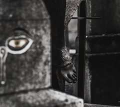(C-47) Tags: pèrelachaisecemetery cemetery selective statues cross meaningful meaning eye wonderful sad sadness composition madeofsteel steel stone stonework flickr feel feelings canon100mml28 onecolor architecture architectural beautiful dof