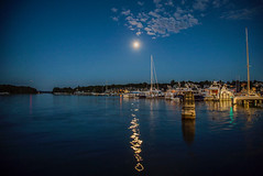 Moonlight Reflections Dance (T P Mann Photography) Tags: marina canon shutter slow michigan charlevoix landscape harbor dock pier mast sailboat yacht boat light evening night summer clouds sky hour blue round lake water dance reflections moonlit moonlight moon