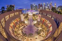 Skyline over the mall... (itsrbtime) Tags: cityscape nightshot bluehour fisheye singapore rijubhattacharya olympus olympusomd olympusem1mkii em1mkii em1ii samyang samyang75mm samyang75mmf35 samyang75mmfisheye skyline esplanade