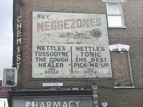 Meggezones ghost sign, 18 Upper Tooting Road, London