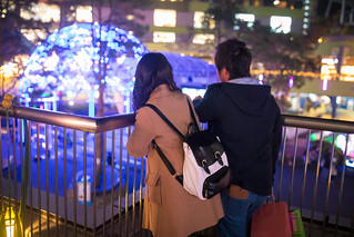 High school couple dating in Christmas lights