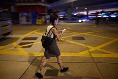 Entering the grid (Bjarne Erick) Tags: hongkong young woman cellphone mobilephone smartphone grid pattern drawing tattoo night walk street