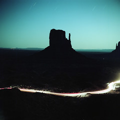 (patrickjoust) Tags: tlr twin lens reflex 120 6x6 medium format c41 color negative film manual focus analog mechanical patrick joust patrickjoust monument valley navajo nation utah arizona border ut az usa us united states north america estados unidos rural desert night after dark cable release tripod long exposure light streak star trails butte mitten rock formation full moon super ricohflex kodak portra 160 tsé bii' ndzisgaii car trail headlights