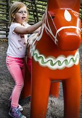 The girl and the Dalcarlia horse at Skansen in Stockholm29/8 2017. (photoola) Tags: stockholm skansen barn child girl sweden photoola djurgården horse