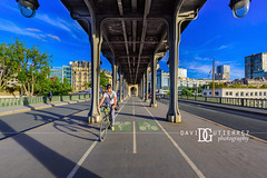 Easy Ride - Pont de Bir-Hakeim, Paris, France (davidgutierrez.co.uk) Tags: architecture city photography davidgutierrezphotography art urban londonphotographer color paris people france nikond810 nikon travel photographer blue 巴黎 パリ 파리 париж parís parigi colors colours colour europe beautiful cityscape davidgutierrez capital structure ultrawideangle champdemars afsnikkor1424mmf28ged 1424mm d810 street arts pontdiéna riverseine summer sunny daytime pontdebirhakeim bridge seineriver archbridge bicycle cycling cyclist