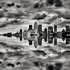 Mirror image of Canary wharf (Neal J.Wilson) Tags: bnw blackandwhite cityscape cities city london docklands canarywharf thames england uk reflection mirrorimage skyscrapper clouds