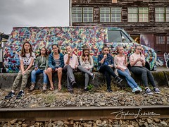 dis-in-ter-est-ed teen-ag-ers (♥Stephanie Larbalestier) Tags: groupphotoshoot photoshoot van rails traintracks train eastvancouver eastside eastvan downtown city citylife gritty decrepit graffitiart art defacement graffiti withdrawn portrait outside casual aloof detached juvenile minors youth adolescents thirteen icecream bored canada bc vancouver strathcona disinterested teens teenagers