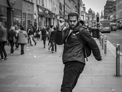 Dancing In The Street (Leanne Boulton) Tags: monochrome people portrait urban street candid portraiture streetphotography candidstreetphotography candidportrait streetportrait streetlife man male face facial expression emotion feeling mood gesture arms dance dancing happiness happy fun tone texture detail depthoffield bokeh naturallight outdoor light shade shadow city scene human life living humanity society culture canon canon5d 5dmkiii 70mm character ef2470mmf28liiusm black white blackwhite bw mono blackandwhite glasgow scotland uk