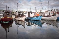 Port of Tórshavn (dam.he) Tags: leicaq tórshavn boot färöer torshavn reflection port northatlantic føroyar reflexion hafen wetreflection färöerinseln leica wasser water bay boote boats faroeislands boat portoftórshavn meer harbour schiffe