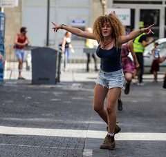 There are some advantages in being young, beautiful, energetic and sexy… (ybiberman) Tags: israel jerusalem citycenter party summerparty technoparty girls adolescent portrait candid streetphotography dancing fun hair curlyhair australianshoes blundstone tongueout