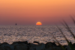 sunset.. (ckollias) Tags: beach beautyinnature day dramaticsky horizon horizonoverwater idyllic nature nopeople orangecolor outdoors red rockobject scenics sea sky sun sunlight sunset tranquilscene tranquility traveldestinations vacations water wave